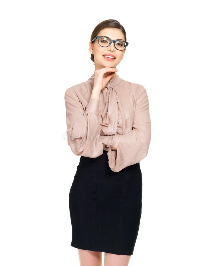 Mulher feliz bonita nos vidros e na camisa com saia preta foto de stock royalty free