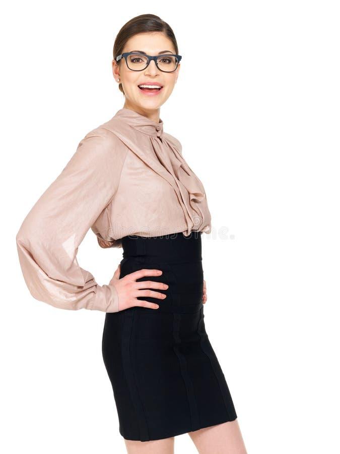 Mulher feliz bonita nos vidros e na camisa com saia preta imagens de stock royalty free
