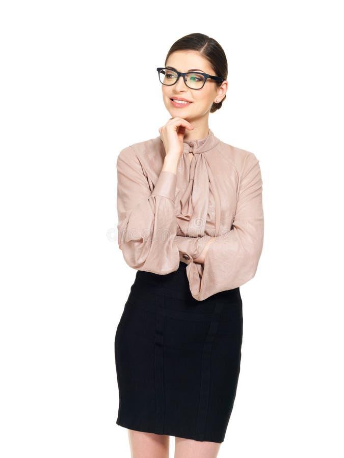 Mulher feliz bonita nos vidros e na camisa com saia preta imagens de stock