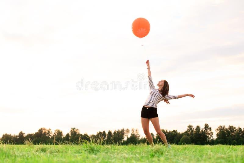 Mulher feliz com balões fotos de stock