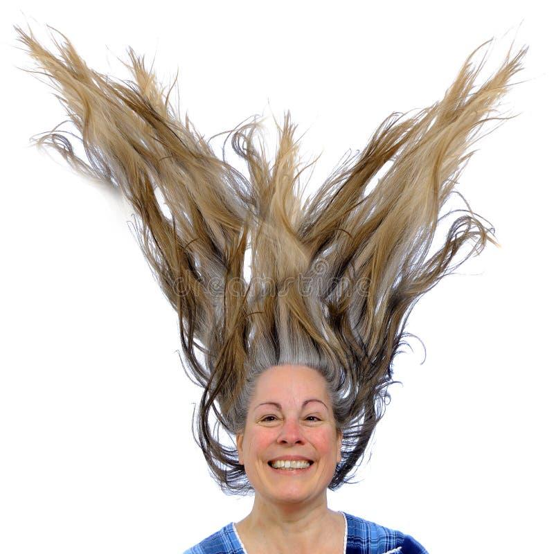 Mulher feliz com cabelo acima fotos de stock