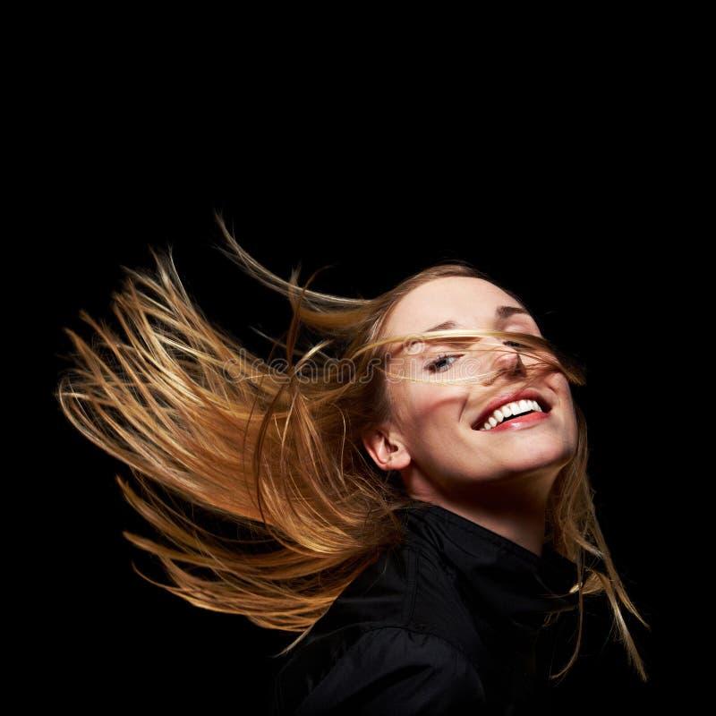 Mulher feliz com cabelo do vôo imagem de stock royalty free