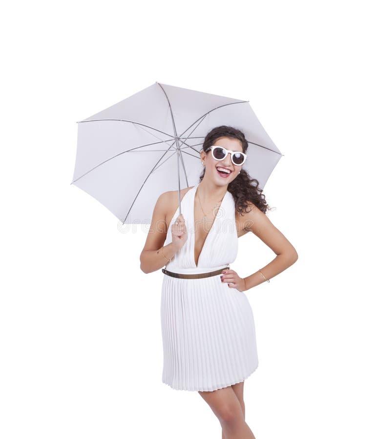 Mulher feliz com guarda-chuva à disposição imagens de stock royalty free