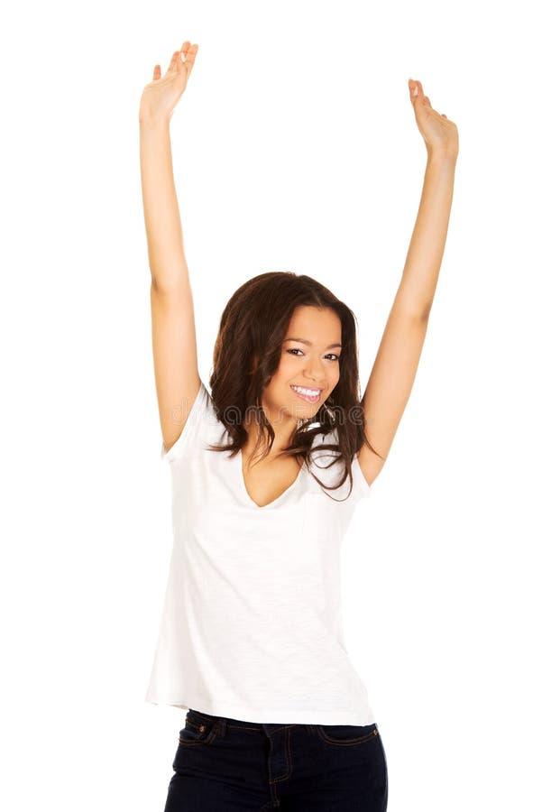 Mulher feliz com mãos acima imagem de stock royalty free