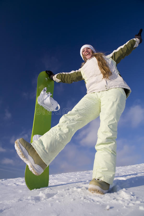 Mulher feliz com snowboard imagem de stock royalty free