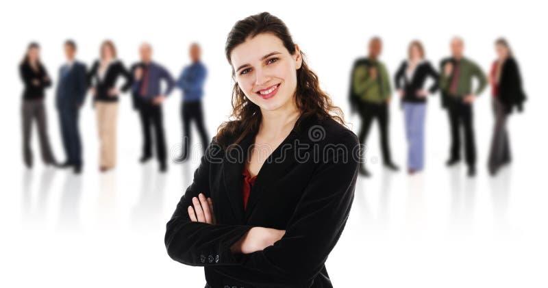 Mulher feliz com sua equipe foto de stock