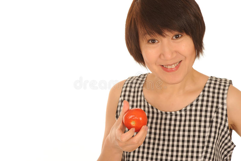 Mulher feliz com tomate fotos de stock royalty free