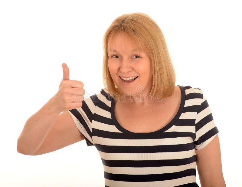 Mulher feliz com um polegar acima imagens de stock royalty free
