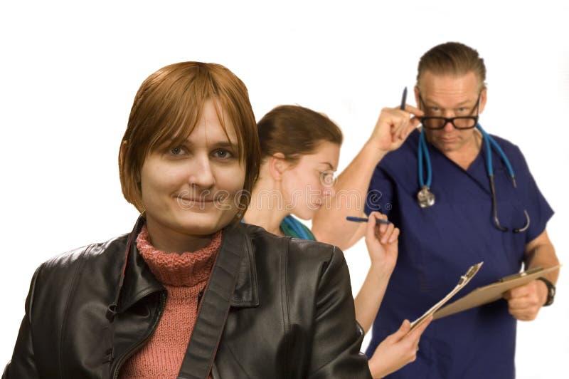 Mulher feliz com verificação médica foto de stock royalty free