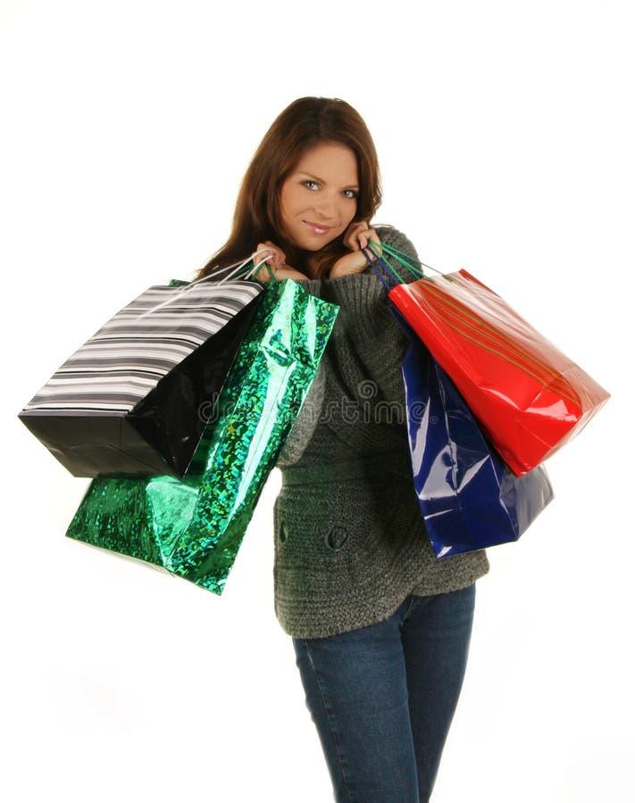 Mulher feliz de compra. Isolado sobre o backgrou branco foto de stock