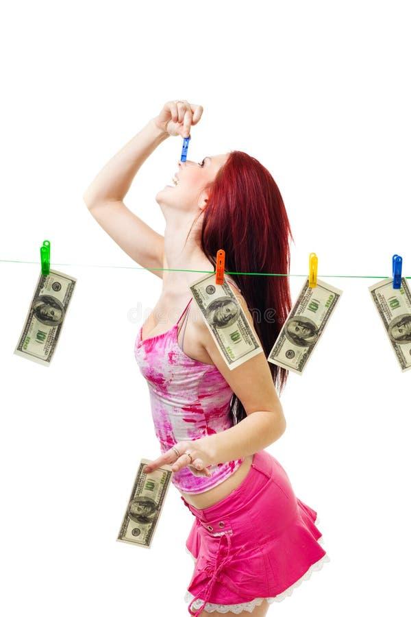 A mulher feliz lava dólares americanos imagem de stock royalty free