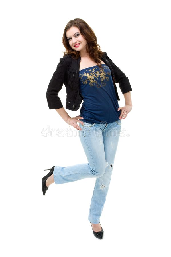 Mulher feliz nas calças de brim imagens de stock royalty free