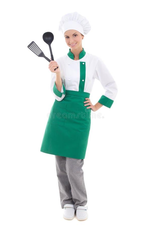 Mulher feliz no uniforme com ferramentas da cozinha - iso completo do cozinheiro chefe do comprimento foto de stock royalty free