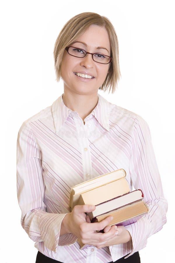 Mulher feliz nova com livros imagem de stock royalty free
