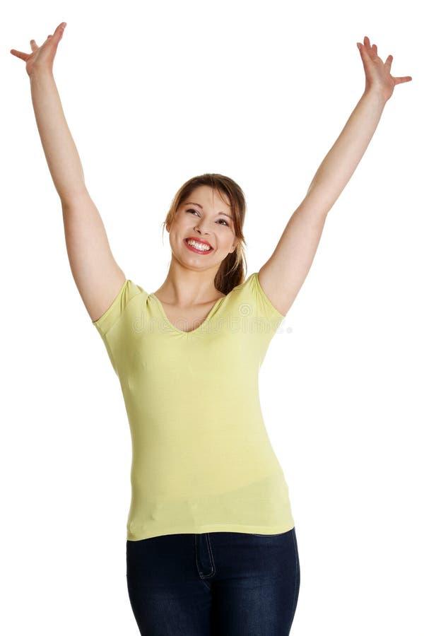 Mulher feliz nova com mãos acima fotos de stock royalty free