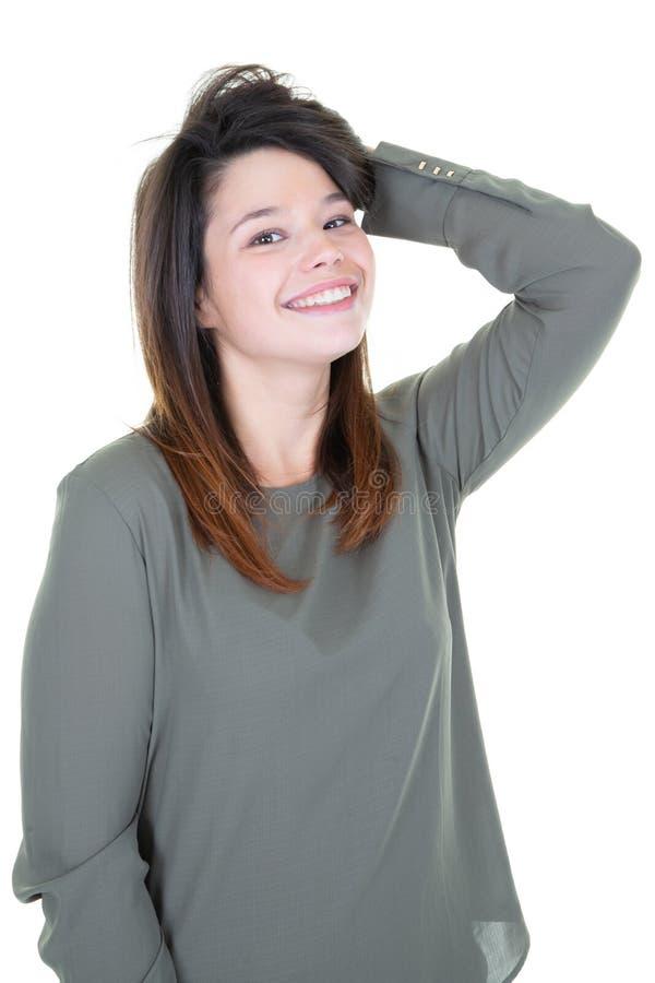 Mulher feliz nova que sorri e que pensa no fundo branco que olha in camera fotografia de stock royalty free