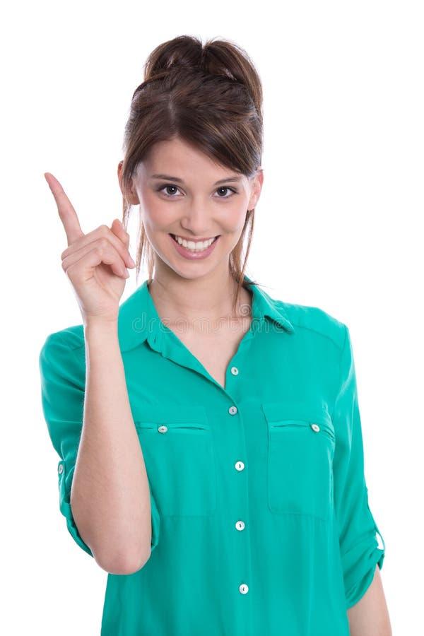 Mulher feliz que aponta acima com seu dedo. imagem de stock royalty free
