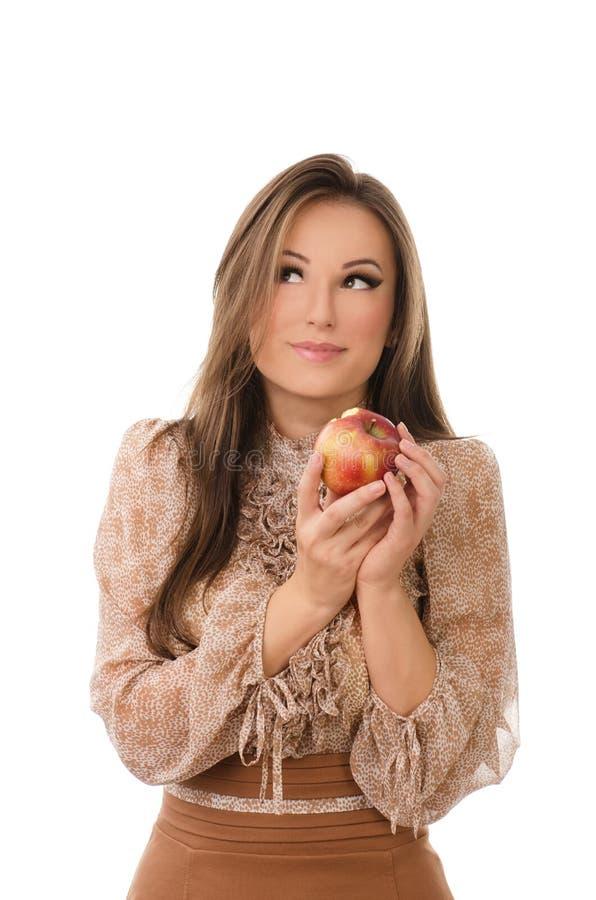 Mulher feliz que come uma maçã imagens de stock