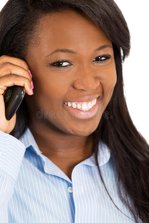 Mulher feliz que fala no telefone esperto foto de stock royalty free