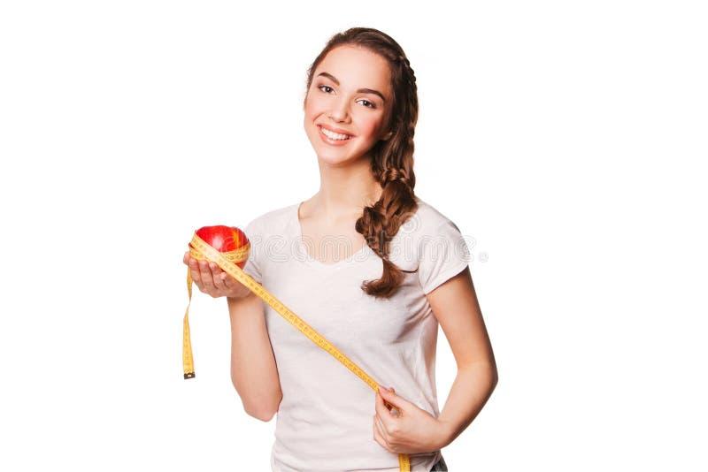 Mulher feliz saudável com maçã vermelha e fita métrica fotos de stock