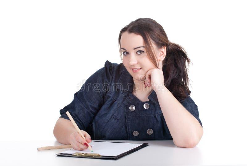Mulher gorda nova desenhando imagem de stock