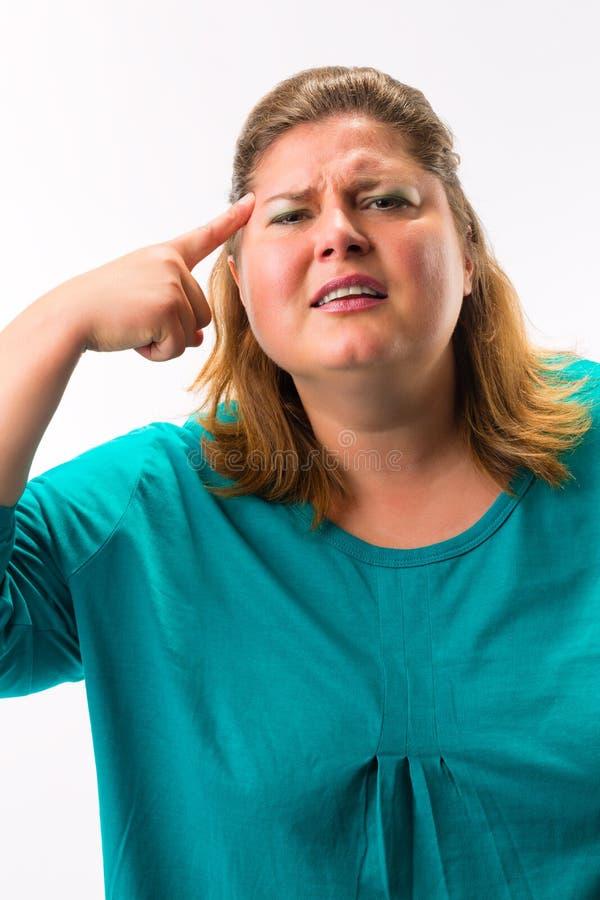 Mulher gorda que tem a dor de cabeça imagem de stock royalty free