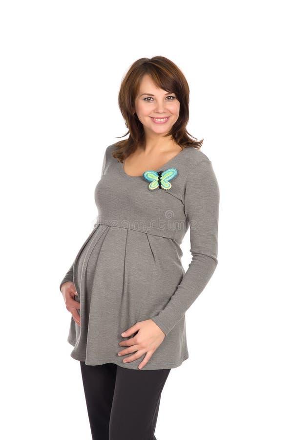 Mulher gravida bonita em uma ligação em ponte cinzenta fotografia de stock royalty free