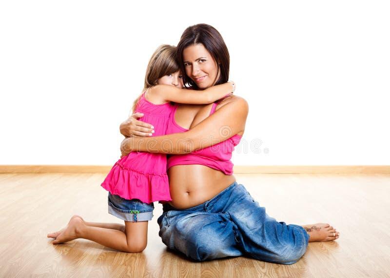 Download Mulher Gravida Com Sua Filha Foto de Stock - Imagem de bonito, criança: 12805668