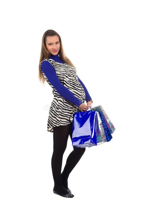Mulher gravida encantadora na compra imagens de stock