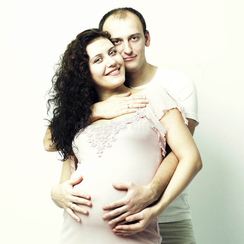 Mulher gravida feliz com marido fotografia de stock royalty free