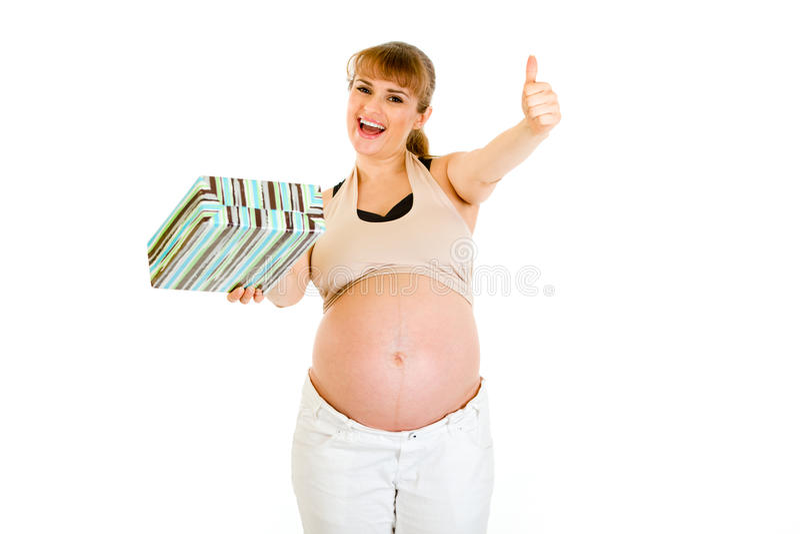 A mulher gravida feliz que mostra os polegares levanta o gesto fotos de stock royalty free