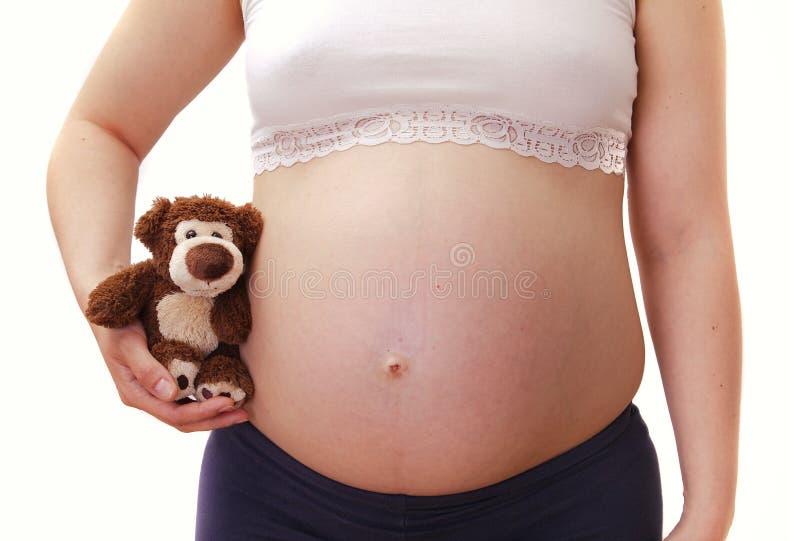 Mulher gravida nova do toughtfull com pulso de disparo imagens de stock