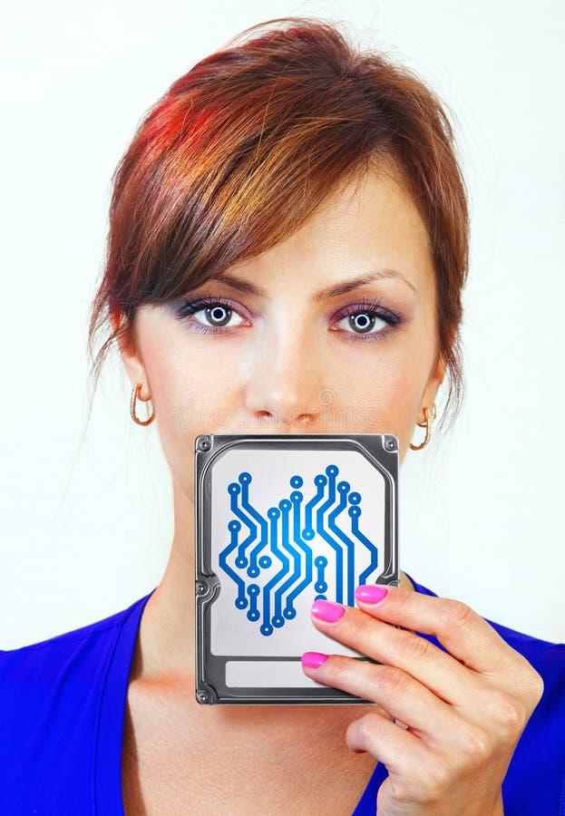 A mulher guarda o dispositivo digital fotos de stock