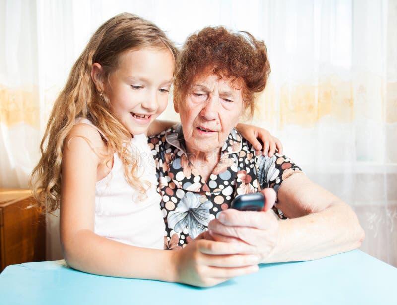 Mulher idosa com bisneto fotografia de stock