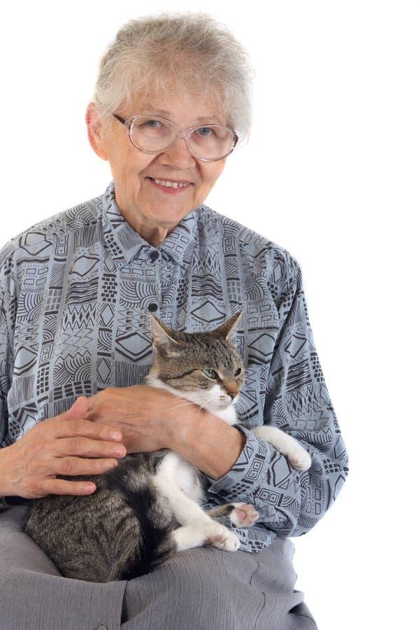 Mulher idosa com gato fotos de stock