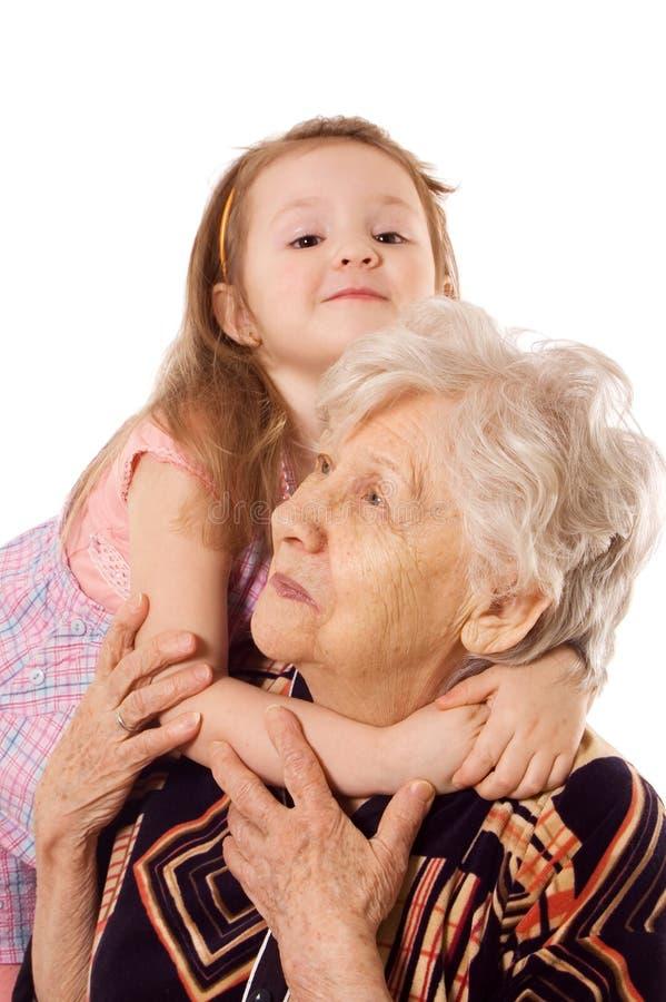 A mulher idosa com a neta fotos de stock royalty free