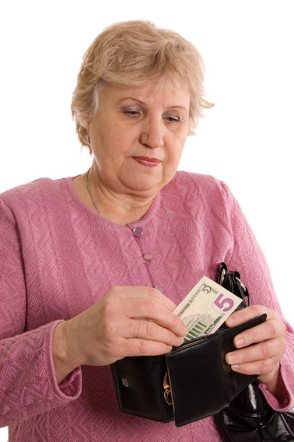 A mulher idosa com uma bolsa foto de stock royalty free
