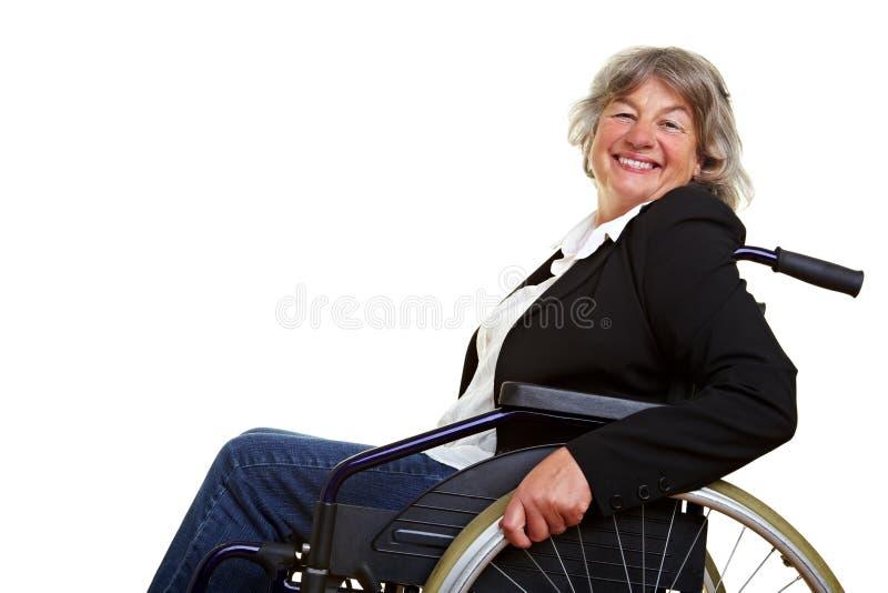 Mulher idosa na cadeira de rodas fotografia de stock royalty free