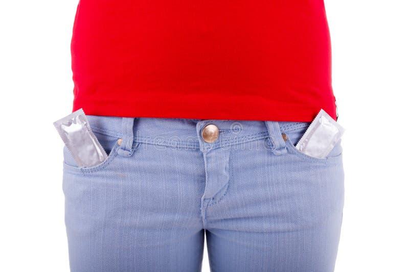 A mulher impede com preservativos fotografia de stock