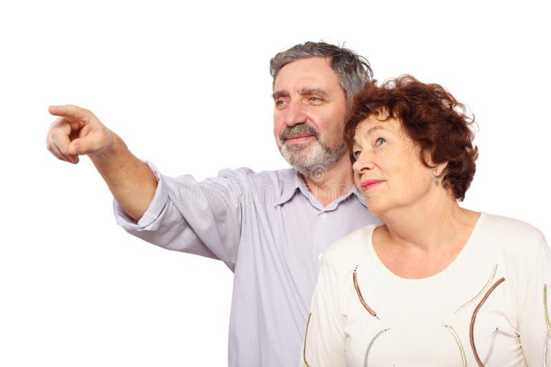 A mulher inclinou-se no homem que mostram o forefinger imagens de stock royalty free