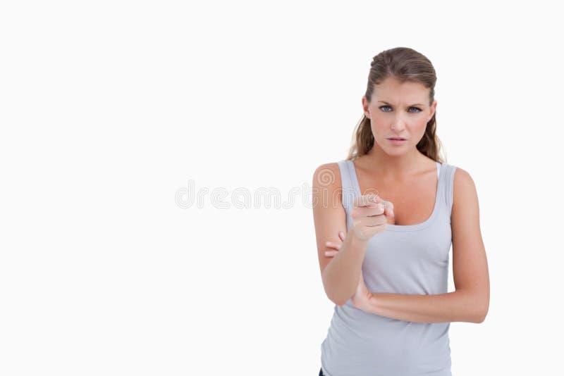 Mulher infeliz que aponta no visor foto de stock royalty free