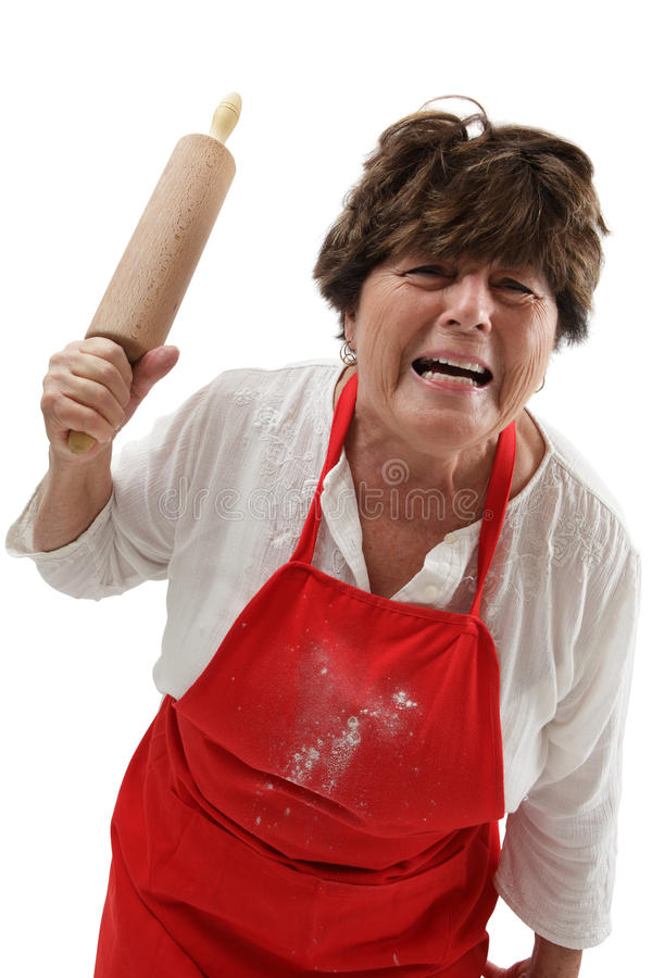 Mulher irritada com pino do rolo imagem de stock