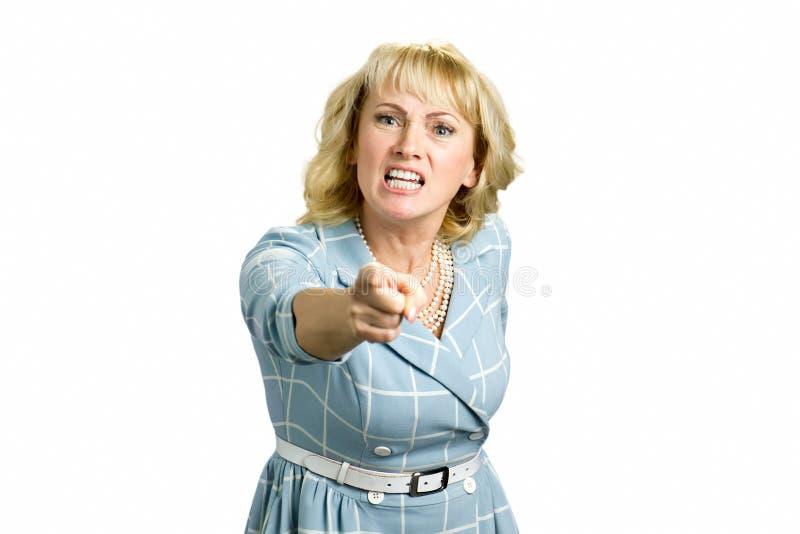 Mulher irritada que grita e que aponta com dedo fotografia de stock