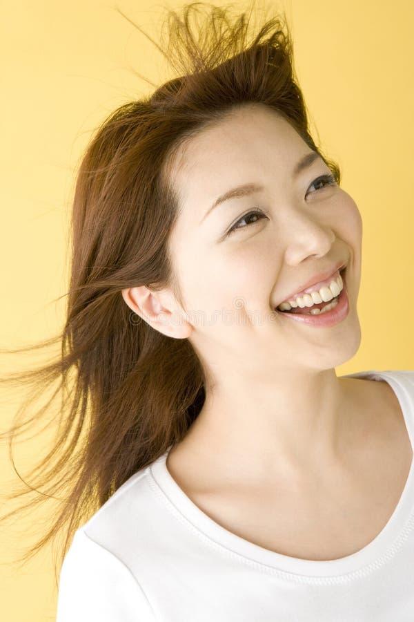 Mulher japonesa de sorriso imagem de stock royalty free