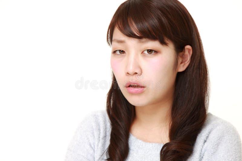 Mulher japonesa nova irritada fotografia de stock