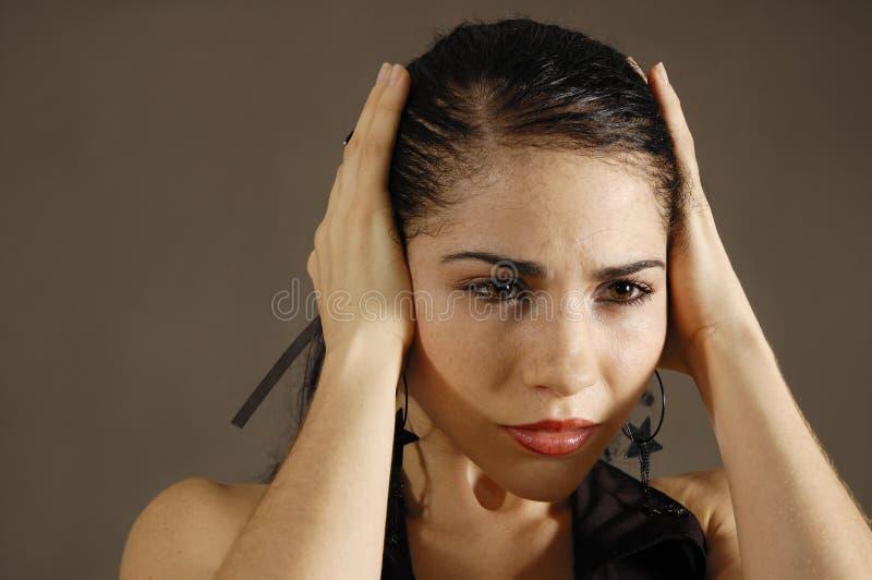 Mulher latino-americano forçada fotografia de stock
