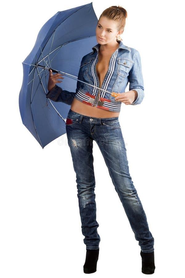 Mulher Leggy em um terno da sarja de Nimes imagem de stock royalty free