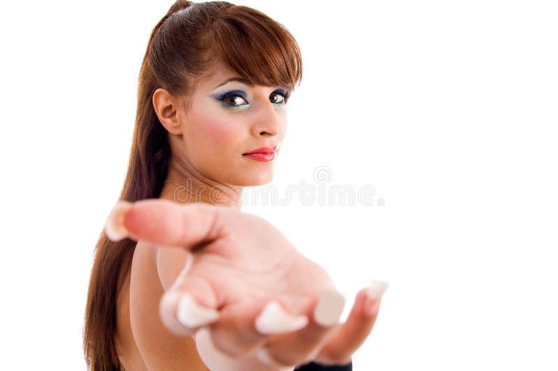 Mulher lindo que mostra o gesto de questão imagem de stock royalty free