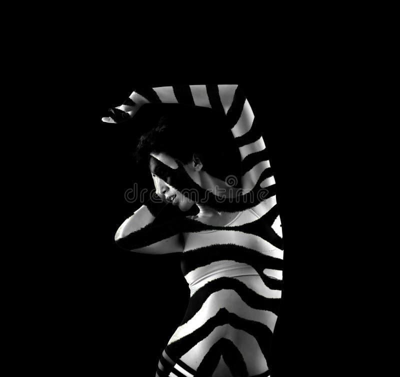 Mulher listrada da zebra foto de stock