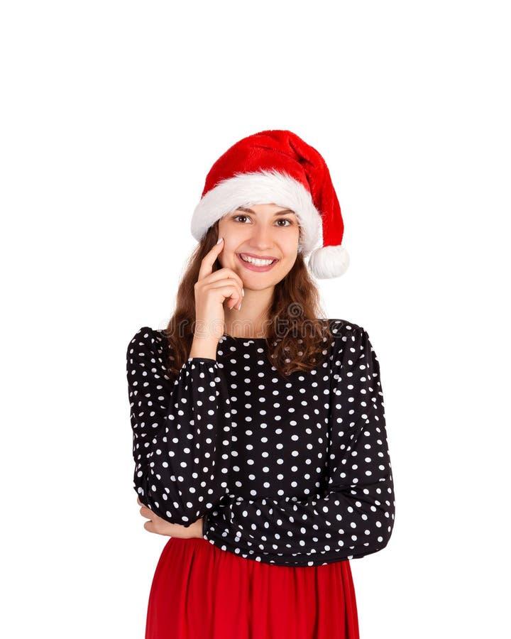 Mulher louca bonita nova no retrato do vestido menina emocional no chapéu do Natal de Papai Noel isolado no fundo branco feriado  imagem de stock royalty free